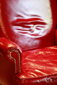 photo of red leather chair on hrexaminer.com article February 17, 2015 from Heather Bussing on sexual harrassment