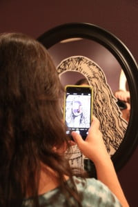 photo of woman taking selfie in mirror on HRExaminer.com article by Heather Bussing April 20, 2015