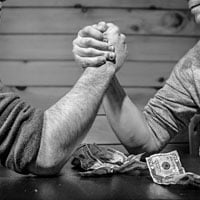 photo of arm wrestling for money in HRExaminer.com feature article v6.31 for August 14, 2015