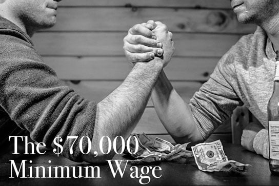 photo of people arm wrestling over money in HRExaminer.com article by Paul Hebert on GravityPayments pay issue