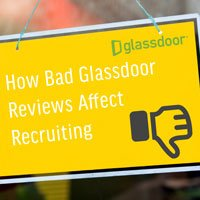 small square crop image of glass window with yellow sign in HRExaminer.com article published September 18, 2015 titled How Bad Glassdoor Review Affect Recruiting