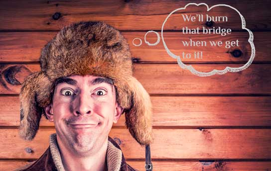photo of man wearing Daniel Boone hat with funny face on HRExaminer.com article published November 18, 2015 Employment Law Blog Carnival on Malapropism