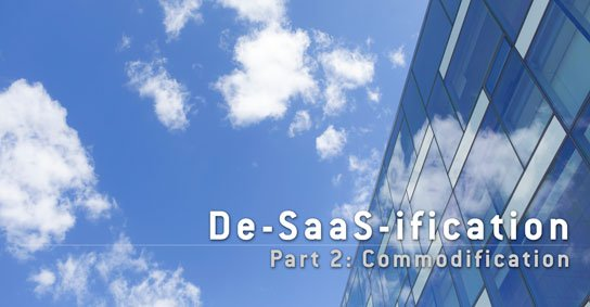 photo of office building with white clouds over blue sky in HRExaminer article, De-Saas-ification part 2