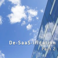photo of office building with white clouds over blue sky in HRExaminer article, De-Saas-ification, part 2, small feature image