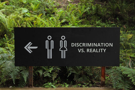 2018-06-25-hrexaminer-photo-img-cc0-via-pexels-by-hafidz-alifuddin-directions-gender-outdoors-88808-full-discrimination-vs-reality-heather-bussing-544x363px.jpg